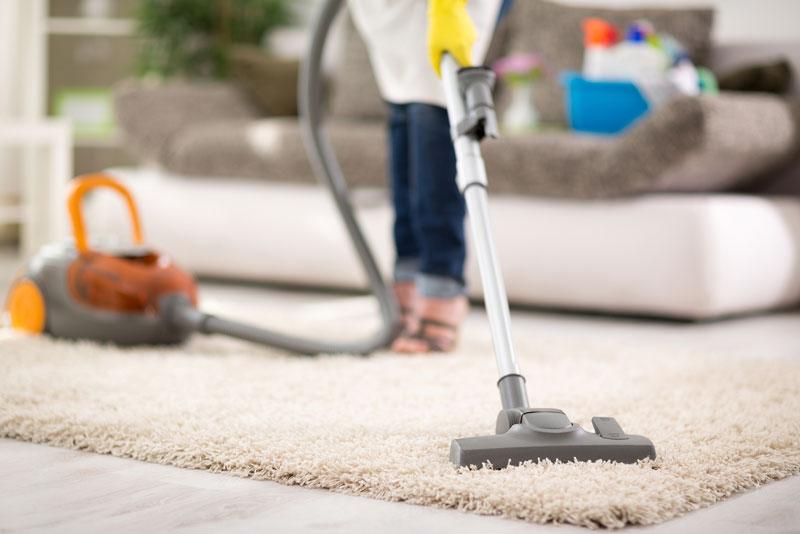 bigstock-Close-up-of-vacuuming-carpet-w-120760328
